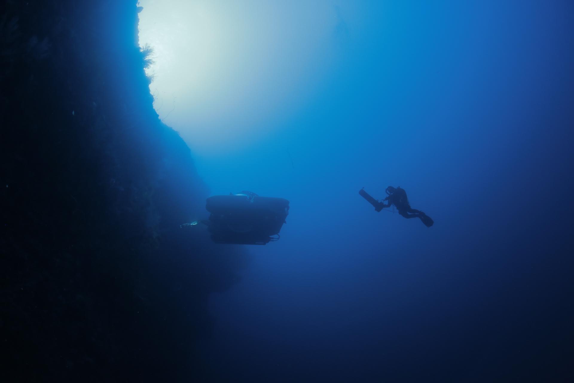 A GUE Diver and sub exploring a wall in Bimini