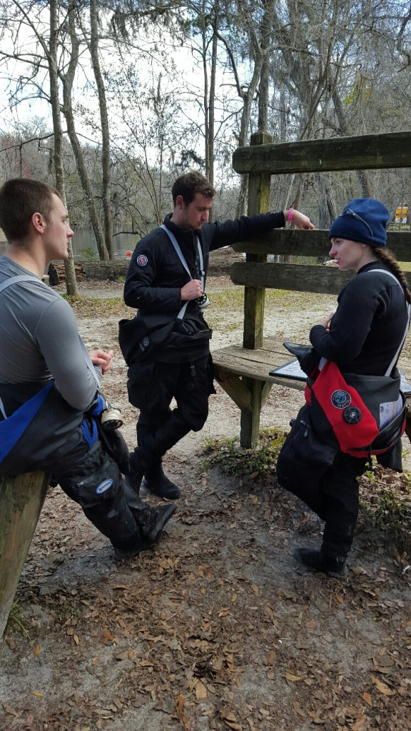 Vince, Jeff, and Mer discussing a dive plan